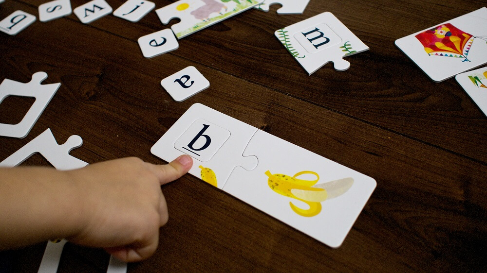 English Alphabet. Educational game. Captain Smart - family board game